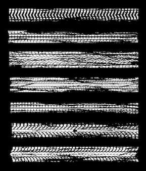 도로 흙으로 자동차 휠 디자인의 타이어 트랙은 그런 지 패턴을 인쇄합니다.