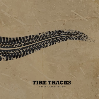 진흙 배경에 타이어 트랙