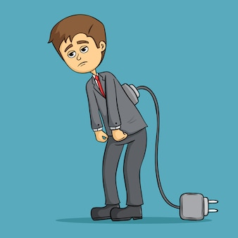 Tired business man low battery with charger cable on blue background