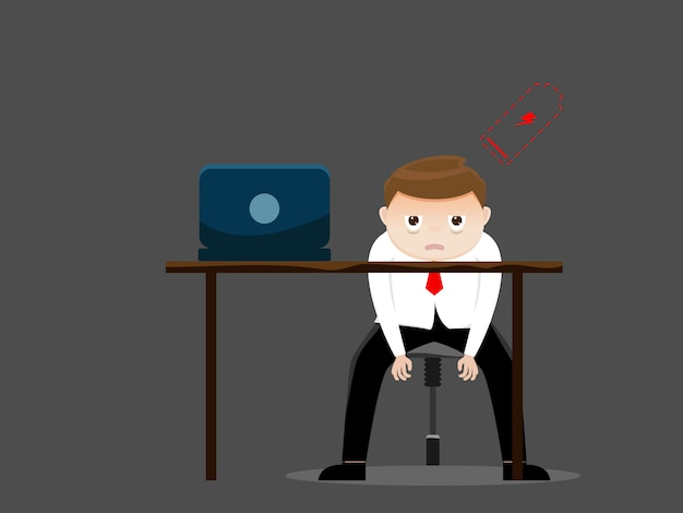 Tired businessman with low battery in office