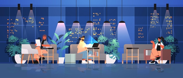 Tired businesspeople working together in creative coworking center teamwork concept dark night office interior horizontal full length