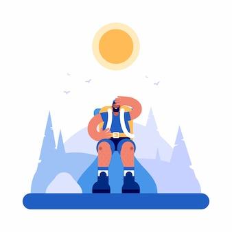 Усталый турист-мужчина сидит и отдыхает в высокогорье