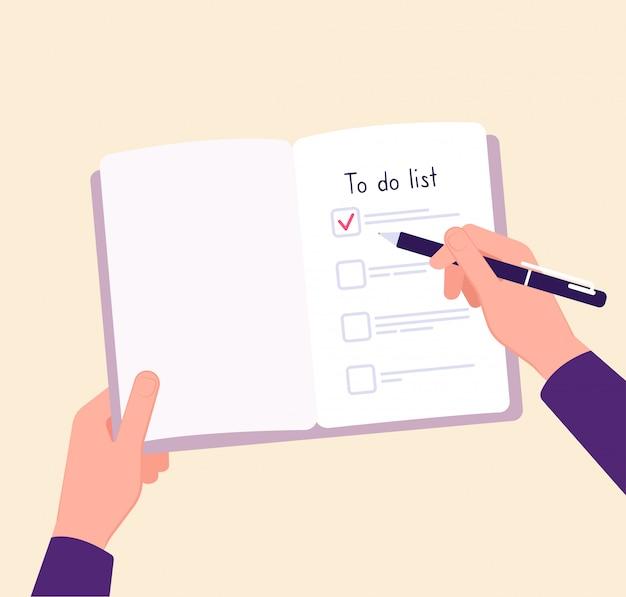 リストの概念を行うには。メモチェックリストを書くテーブルの手。完全な事業計画のコンセプト