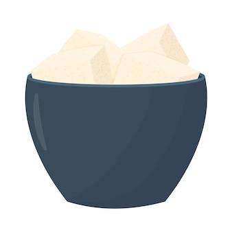 青いプレートの豆腐チーズ白い背景で隔離のボウルに大豆チーズ