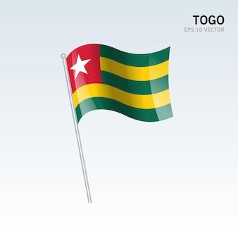 Togo waving flag isolated on gray background