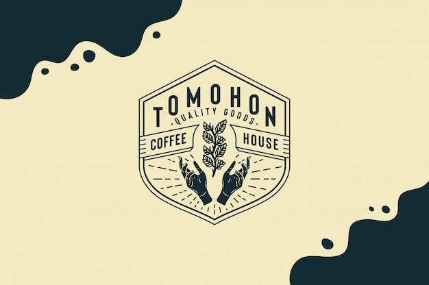 Tomohon coffee house quality goods with coffee leaf in hand logo fully editable text, color and outline