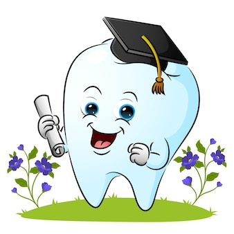 The tooth is wearing the graduate hat and holding a paper of illustration