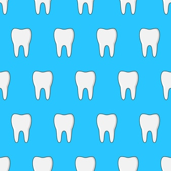 Tooth seamless pattern on a blue background. clean teeth theme vector illustration