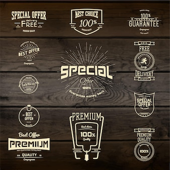 Top quality badges logos and labels. on wooden  texture