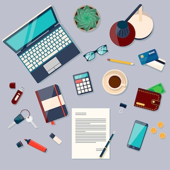 Top view of desk background with laptop, digital devices, office objects, books and documents