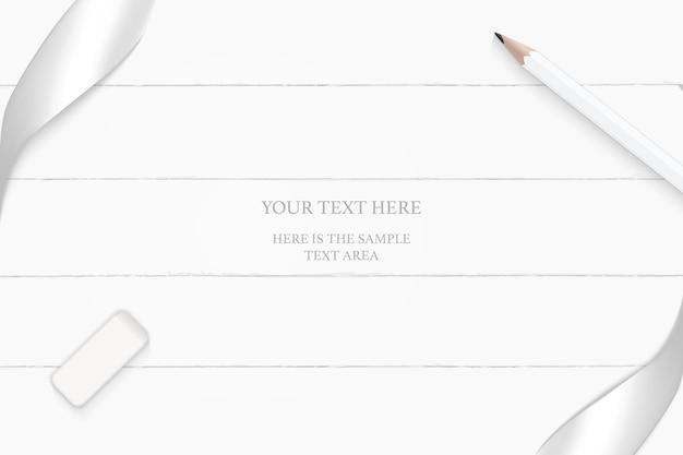 木の床の背景にエレガントな白い構成のシルバーリボン鉛筆と消しゴムの上面図。