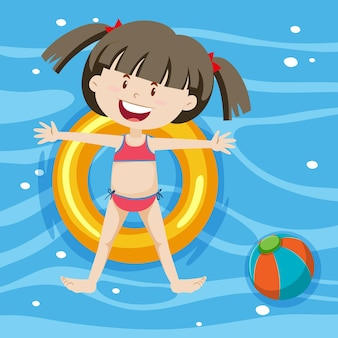Top view of a girl laying on swimming ring on pool background
