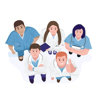 Top view of happy doctors and nurses standing looking up at camera.