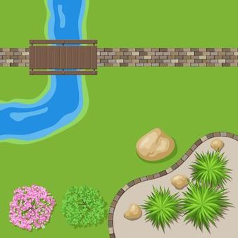 石の小道と木製の橋のある平面図の風景庭園。