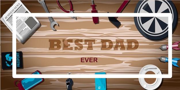 Вид сверху на фон со спортивным инвентарем. надпись - лучшая открытка для папы на день отца.