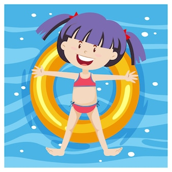 プールの背景に浮き輪に横たわっている女の子の上面図
