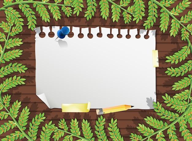 葉の要素とテーブルの上の白紙の上面図