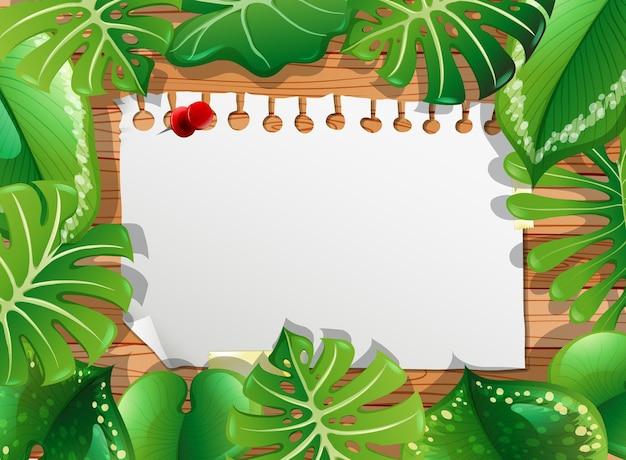 Вид сверху чистого листа бумаги на столе с элементами листьев