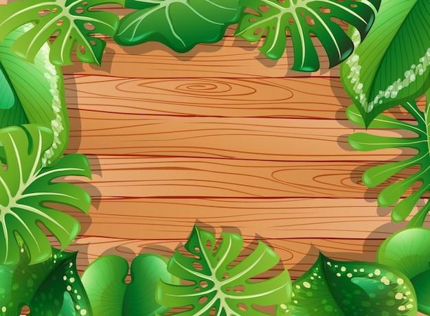 Вид сверху пустой деревянный стол с элементами листьев