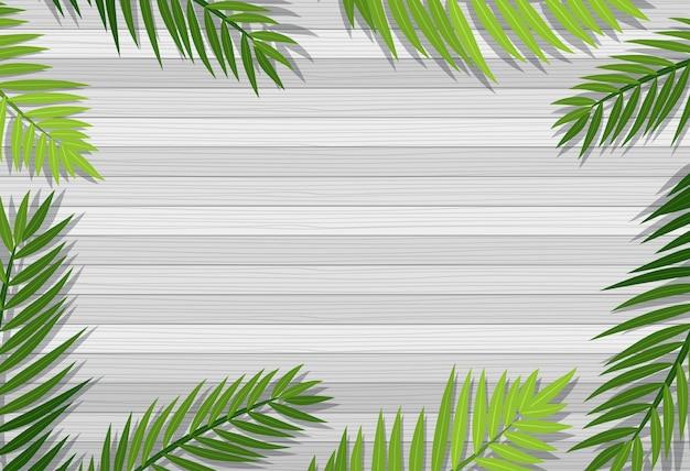 葉の要素を持つ空白の木製テーブルの上面図