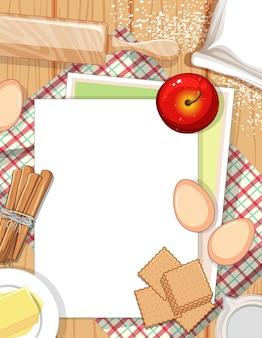 ベーカリーの材料要素とテーブルの上の空の紙の上面図