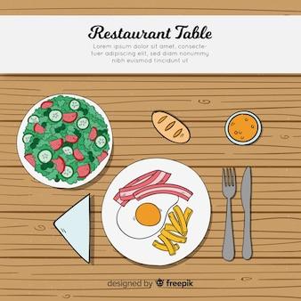 手を引く現代的なレストランのテーブルのトップビュー
