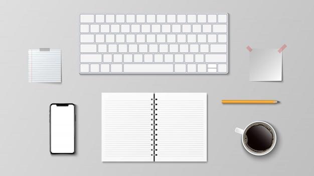 Вид сверху современного рабочего места, клавиатура кофе бумага карандашом на белом фоне