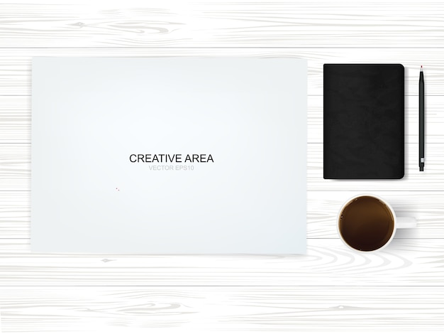 Вид сверху бумажный фон рабочего пространства с чашкой кофе