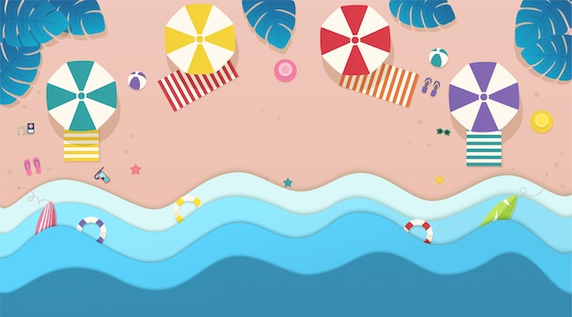 Top view sea, the beach with umbrellas, sun beds and tropical leaves background