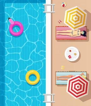 Top view, swimming pool with clear water, inflatable circles and girls  dressed in swimsuits lying down on sunloungers and sunbathing. summer time poster.