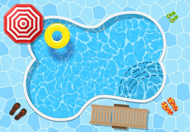 Top view of swimming pool with parasol and other beach things.