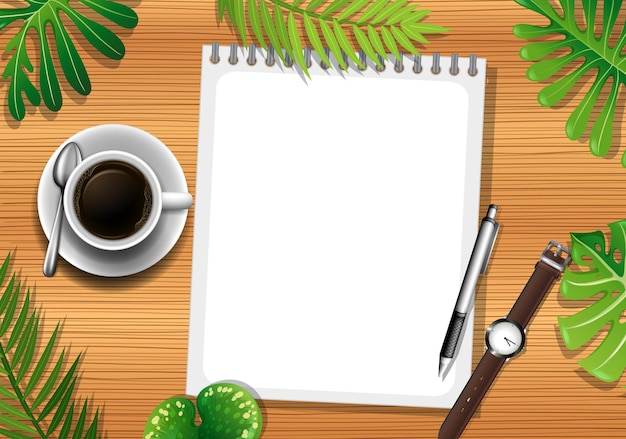 Top view of wooden table with blank paper and office objects and leaves element