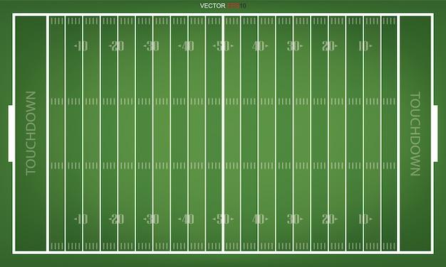 アメリカのフットボールのフィールドのトップビュー。スポーツの背景の緑の草のパターン。