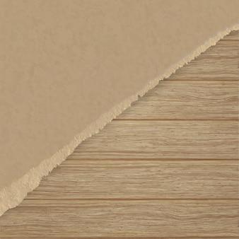 Сорванная коричневая текстурируя бумага над деревянной стеной планки.