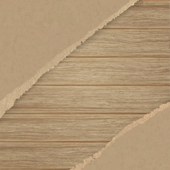 Torn brown texturing paper over a wooden plank wall.