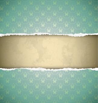 Torn green ornamental wallpaper