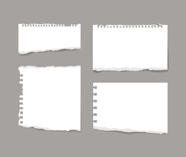 引き裂かれたノートノートの紙片が灰色の背景に分離された現実的なベクトル図