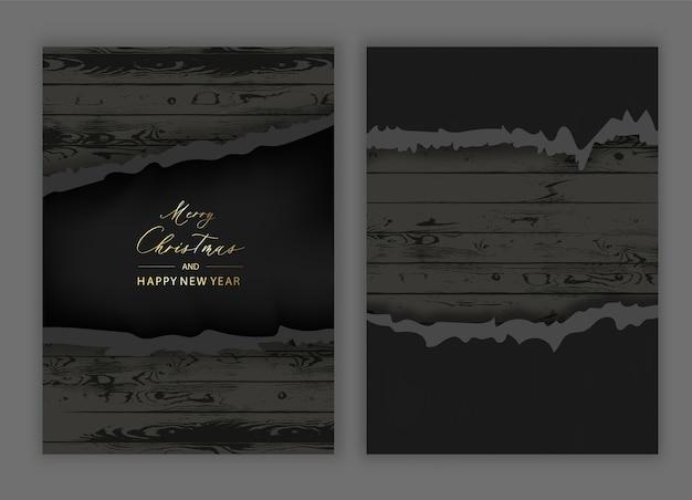 Torn paper on old wooden black background .