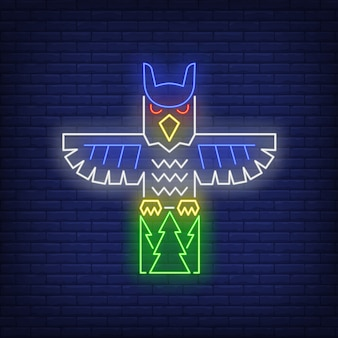Totem pole with owl neon sign