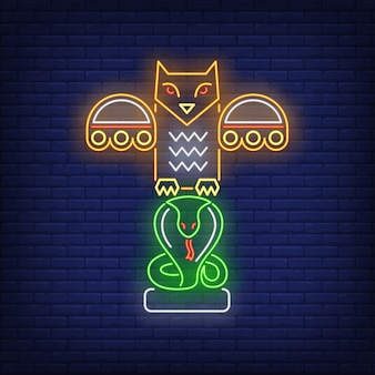 Totem pole with owl and snake neon sign