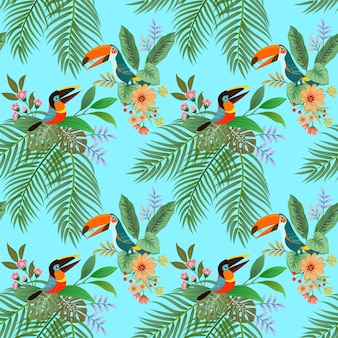 Toucan bird and flowers seamless pattern on blue background.