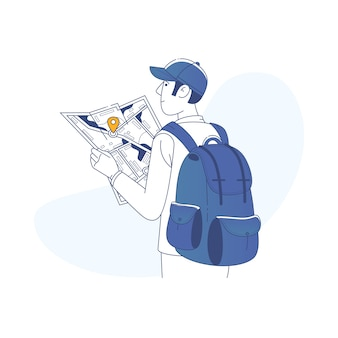 Tourist boy with a backpack in a big city is watching a map
