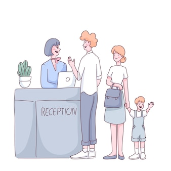 Tourist family standing at airport checkin counter