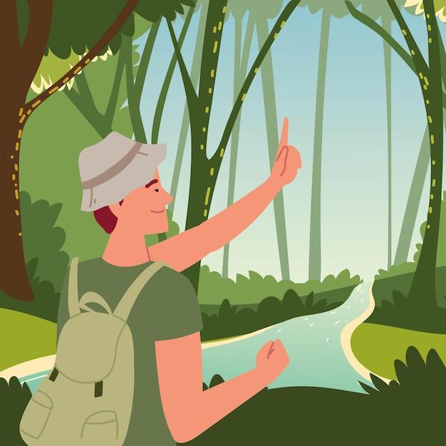 Туристический человек в лесу с рекой