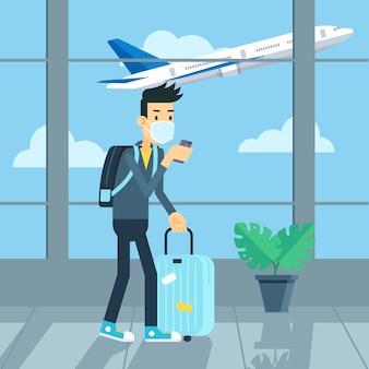 コロナウイルスとニューノーマルのために空港でマスクを着ている観光客