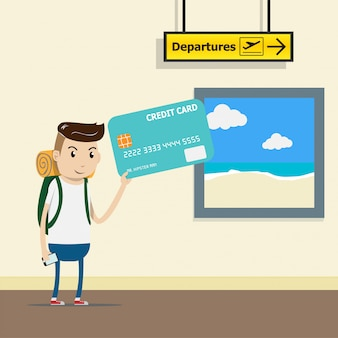 Tourist with backpack at the airport terminal with credit card in hand