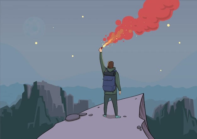 Tourist with the flare on a mountain is looking from the top.