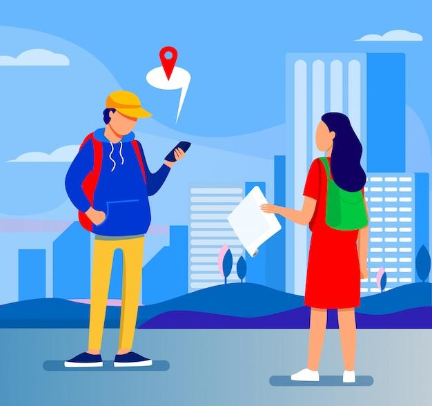 紙の地図で目的地を尋ねる観光客