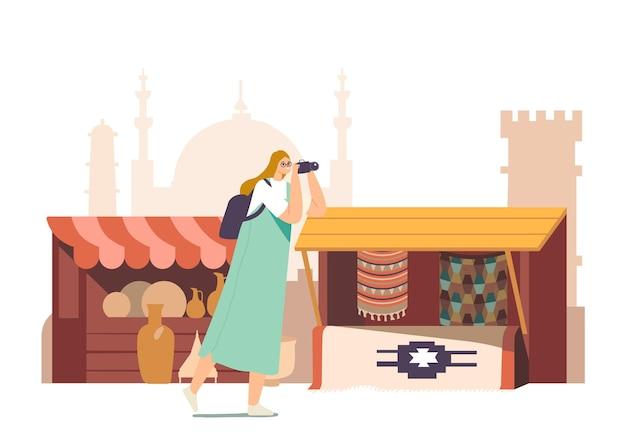 写真カメラで観光客の女性キャラクターがアラビア市場のコンセプトを訪問