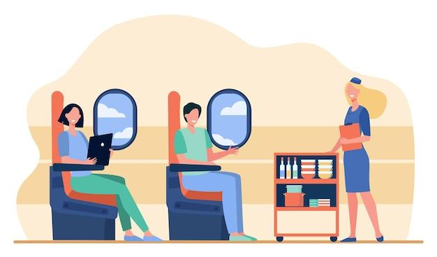 비행기로 여행하는 관광객. 비행기 승객에게 음식을 배달하는 스튜어디스